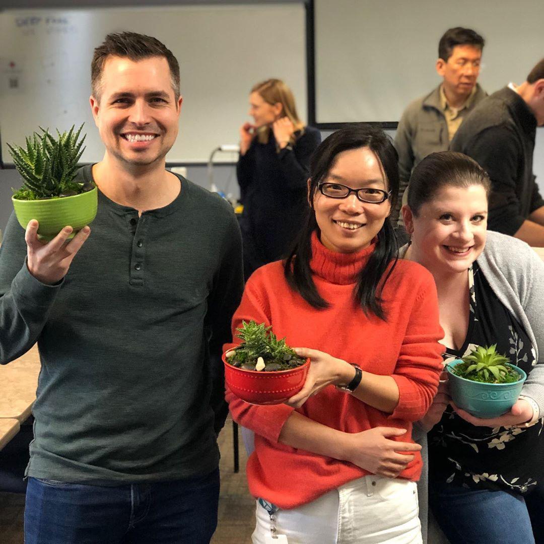 TechSmithies holding plants.