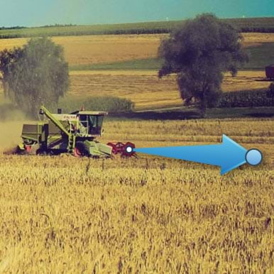 tractor in field with animation arrow overlay