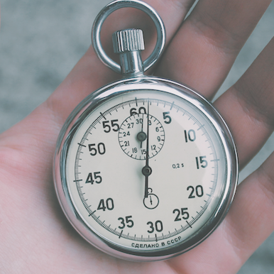 image of 60-second stopwatch in hand